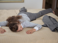 Tired business woman fall down from exhaustion in hotel room